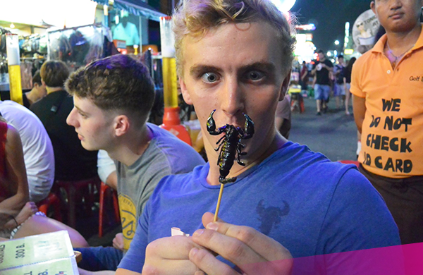 Eating a scorpion in Bangkok
