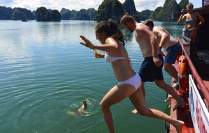 Ultimate Vietnam group jumps of boat in Halong Bay