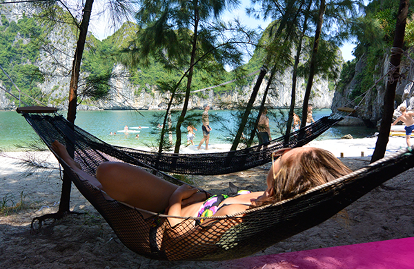 Chill in the hammock on our private island in Halong Bay