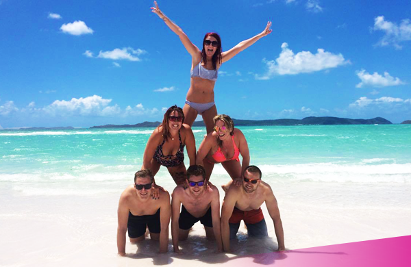 Whitehaven beach, friends making a pyramid