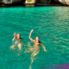 Backpackers swimming at Cathedral Cove